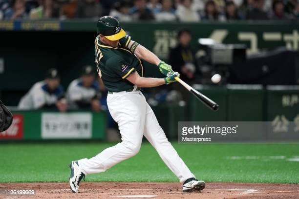 Outfielder Stephen Piscotty of the Oakland Athletics hits a solo homer to make it 10 in the top of 2nd inning during the preseason friendly game...