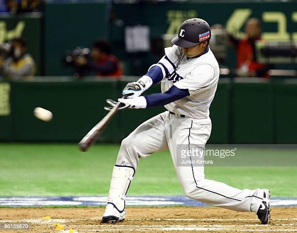 Outfielder Takumi Kuriyama of Saitama Seibu Lions hits a RBI single in the top of the eighth inning during a friendly match between Japan and Saitama...