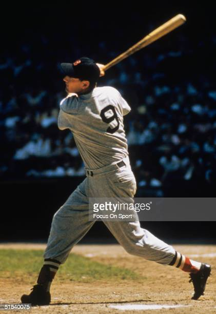 Outfielder Ted Williams of the Boston Red Sox swings away during the 1950s