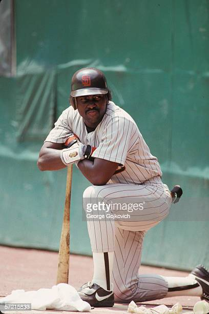 Outfielder Tony Gwynn of the San Diego Padres kneels on deck while waiting to bat against the Pittsburgh Pirates at Three Rivers Stadium circa 1992...