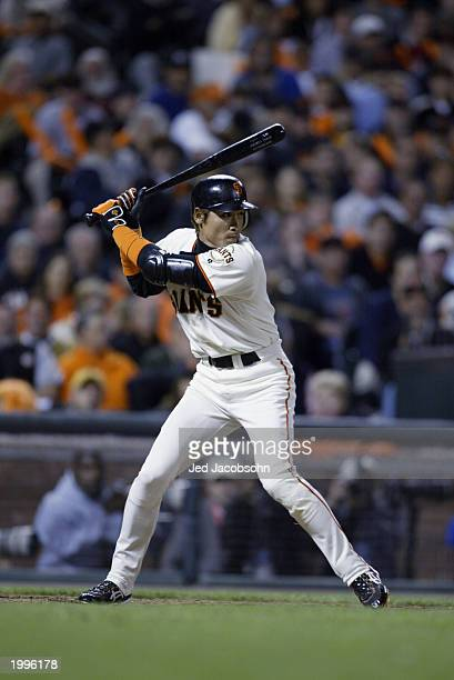 Outfielder Tsuyoshi Shinjo of the San Francisco Giants waits for the St Louis Cardinals pitch during game four of the National League Championship...