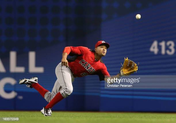 Outfielder Tyson Gillies of Canada makes a diving catch against Italy during the fifth inning of the World Baseball Classic First Round Group D game...