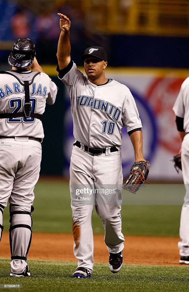 Outfielder Vernon Wells #10 of the Toronto Blue Jays is congratulated by his teammates after the game against the Tampa Bay Rays on August 26, 2008 at Tropicana Field in St. Petersburg, Florida.