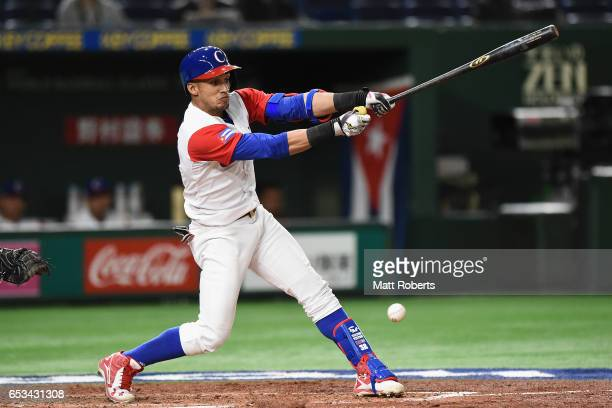 Outfielder Victor Mesa of Cuba grounds out in the bottom of the third inning during the World Baseball Classic Pool E Game Five between Netherlands...