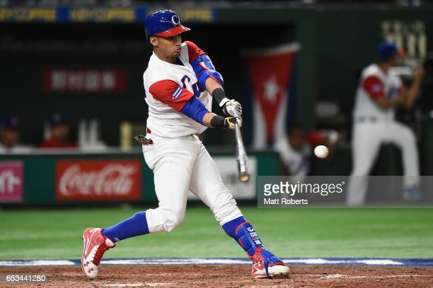 Outfielder Victor Mesa of Cuba hits a RBI double to make it 131 in the bottom of the fifth inning during the World Baseball Classic Pool E Game Five...