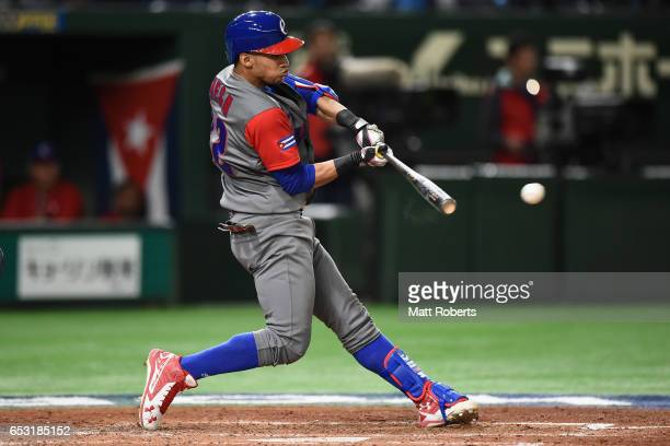 Outfielder Victor Mesa of Cuba hits a two run single to make it 4-2 in the top of the fourth inning during the World Baseball Classic Pool E Game...