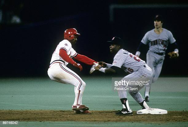 Outfielder Vince Coleman of the St Louis Cardinals gets back to second base safe as Al Newman of the Minnesota Twins waits on the throw in a World...