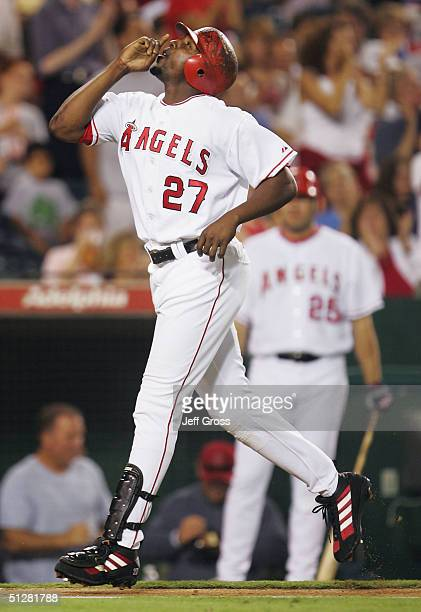 Outfielder Vladimir Guerrero of the Anaheim Angels points to the sky after hitting a solo homerun in the fourth inning during their game against the...