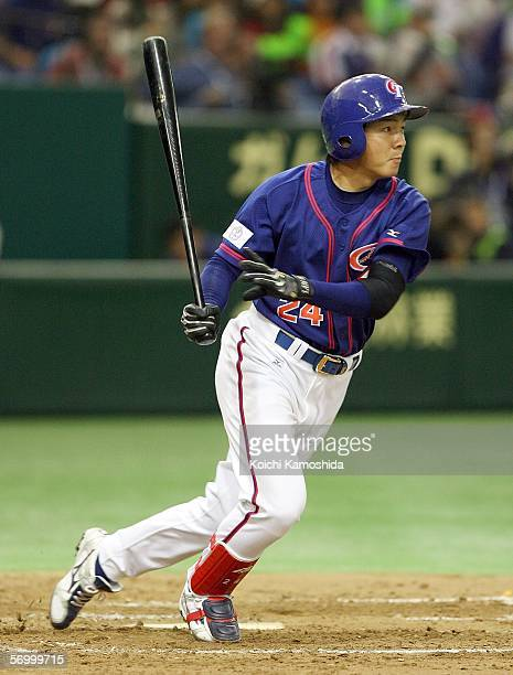 Outfielder WeiChu Lin of Chinese Taipei runs to the first base during the first round of the 2006 World Baseball Classic at the Tokyo Dome on March 5...