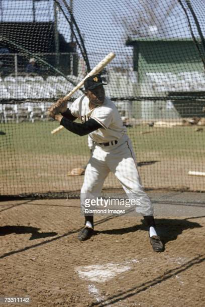 Outfielder Willie Mays of the New York Giants in the batting cage prior to a Spring Training game against the Baltimore Orioles in March 1957 in...