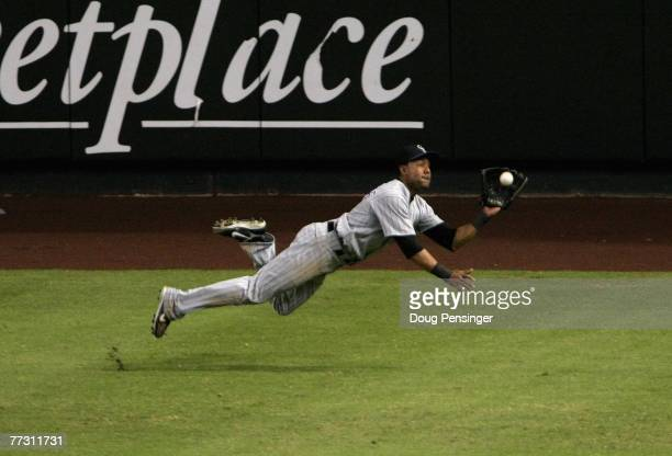 Outfielder Willy Taveras of the Colorado Rockies makes a diving catch against the Arizona Diamondbacks during the seventh inning of Game Two of the...