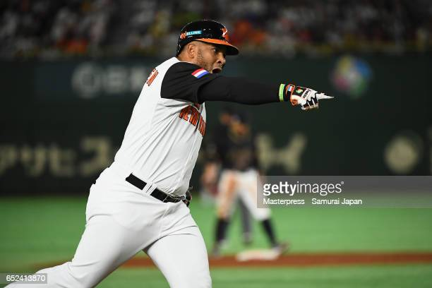 Outfielder Wladimir Balentien of the Netherlands celebrates after hitting a two run homerun to make it 5-5 in the bottom of the third inning during...
