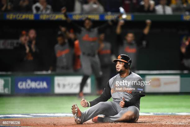 Outfielder Wladimir Balentien of the Netherlands celebrates after scoring a run by a RBI double of Desingated hitter Didi Gregorius of the...