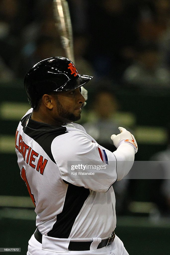 Outfielder Wladimir Balentien #4 of the Netherlands hits a three-run double in the bottom half of the sixth inning during the World Baseball Classic Second Round Pool 1 game between Japan and the Netherlands at Tokyo Dome on March 10, 2013 in Tokyo, Japan.