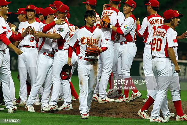 Outfielder Xiao Cui of China celebrates winning with teammates during the World Baseball Classic First Round Group A game between China and Brazil at...