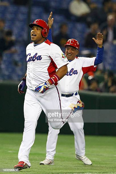 Outfielder Yasmany Tomas of Cuba celebrates after scoring hits a three run home run in the top half of the sixth inning during the World Baseball...