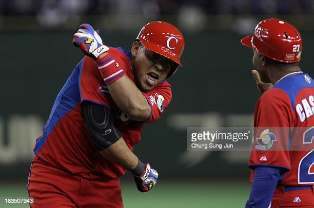 Outfielder Yasmany Tomas of Cuba reacts after hitting a RBI single in the eighth inning during the World Baseball Classic Second Round Pool 1 game...