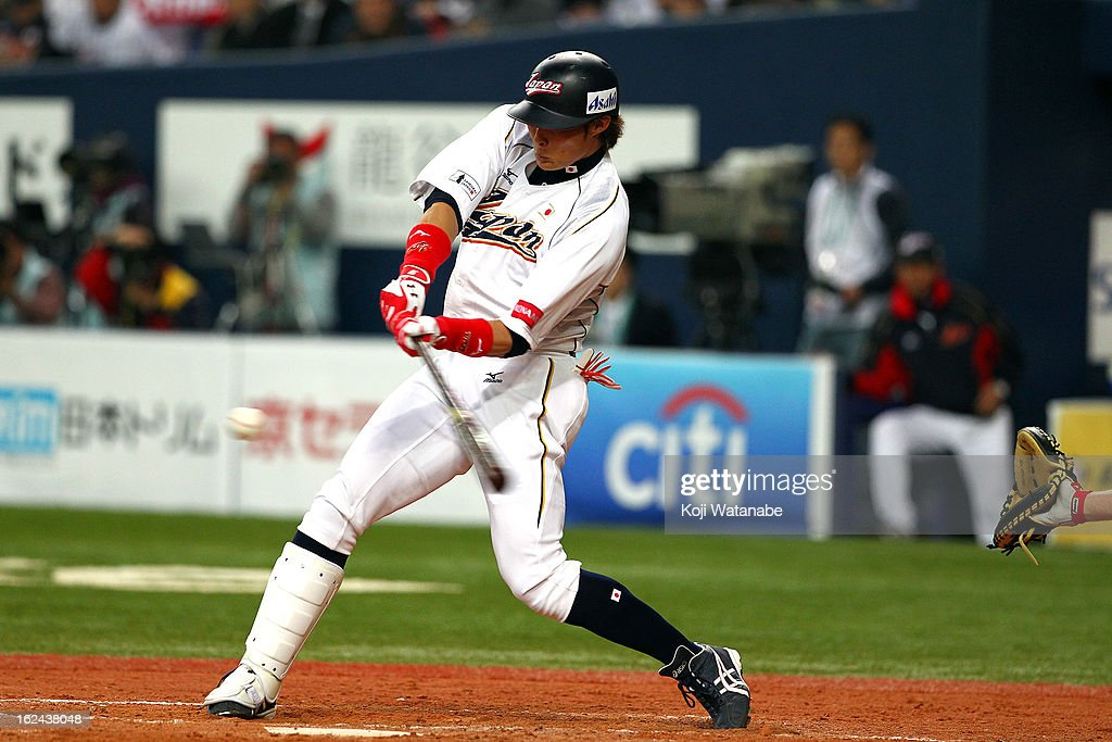 Outfielder Yoshio Itoi #9 of Japan at bat during international friendly game between Japan and Australia at Kyocera Dome Osaka on February 23, 2013 in Osaka, Japan.
