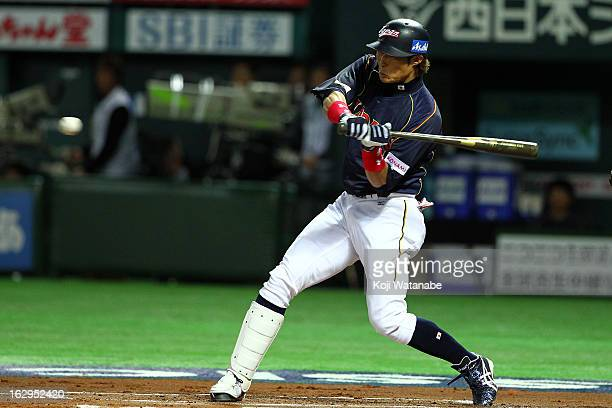 Outfielder Yoshio Itoi of Japan at bat during the World Baseball Classic First Round Group A game between Brazil and Japan at Fukuoka Yahoo Japan...