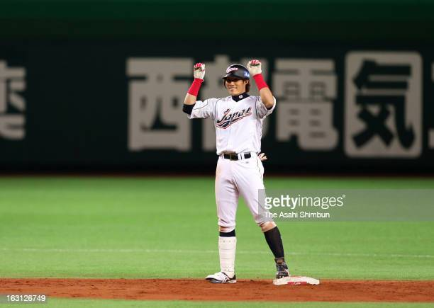 Outfielder Yoshio Itoi of Japan reacts after hitting a threerun double in the bottom half of the fifth inning during the World Baseball Classic First...