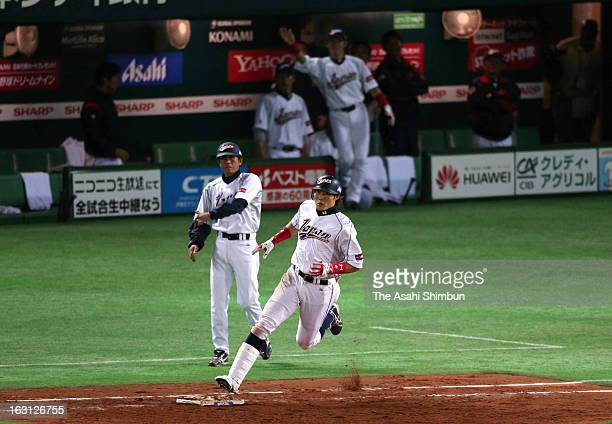 Outfielder Yoshio Itoi of Japan runs after hitting a threerun double in the bottom half of the fifth inning during the World Baseball Classic First...