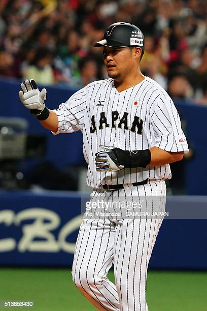 Outfielder Yoshitomo Tsutsugo of Japan celebrates after scoring to make 04 by the two run single by outfielder Ryosuke Hirata in the bottom of third...