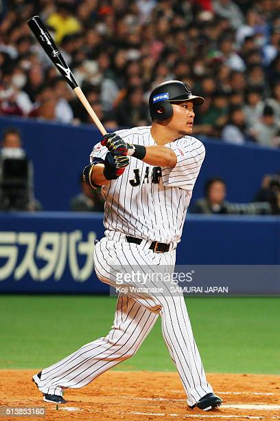 Outfielder Yoshitomo Tsutsugo of Japan hits a double in the bottom of third inning during the international friendly match between Japan and Chinese...