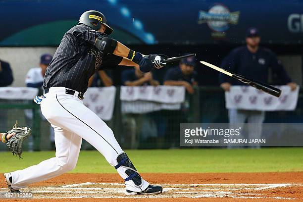 Outfielder Yoshitomo Tsutsugo of Japan hits a RBI single with breaking his bat in the top of sixth inning during the WBSC Premier 12 match between...