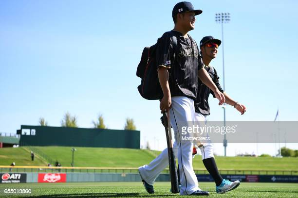 Outfielder Yoshitomo Tsutsugoh and Infielder Ryosuke Kikuchi of Japan are seen prior to the exhibition game between Japan and Chicago Cubs at Sloan...