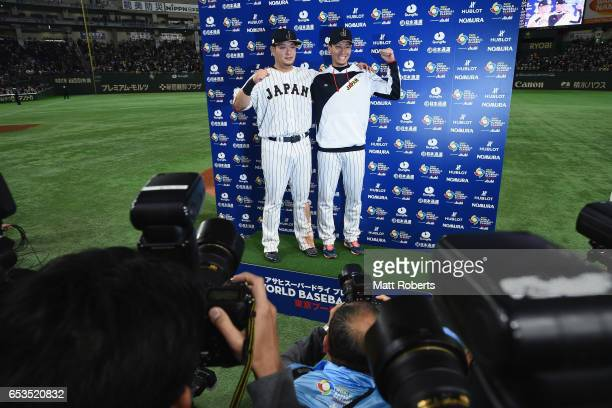 Outfielder Yoshitomo Tsutsugoh and Pitcher Kohdai Senga of Japan pose for photographs during the interview after the World Baseball Classic Pool E...