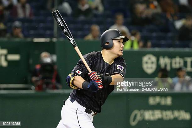 Outfielder Yoshitomo Tsutsugoh of Japan grounds out while Designated hitter Shohei Ohtani of Japan scores in the fifth inning during the...