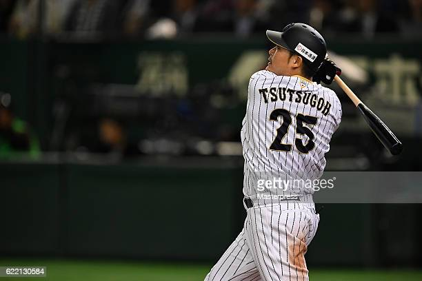 Outfielder Yoshitomo Tsutsugoh of Japan hits a RBI double in the fifth inning during the international friendly match between Japan and Mexico at the...