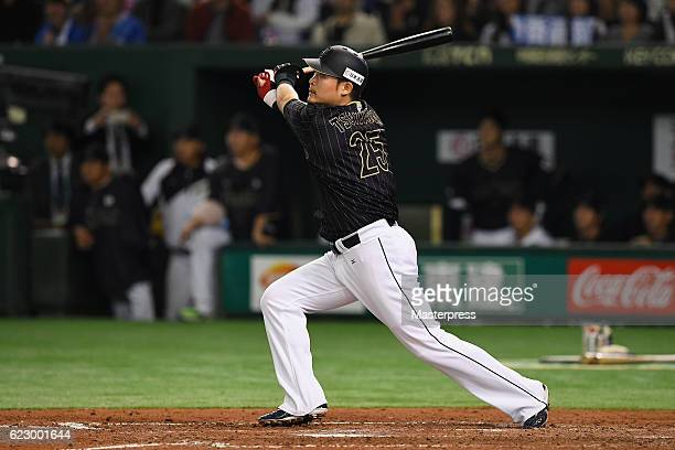 Outfielder Yoshitomo Tsutsugoh of Japan hits a RBI double in the seventh inning during the international friendly match between Netherlands and Japan...