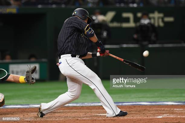 Outfielder Yoshitomo Tsutsugoh of Japan hits a tworun homer in the top of the eighth inning during the World Baseball Classic Pool B Game Three...