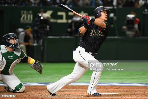 Outfielder Yoshitomo Tsutsugoh of Japan hits a two-run homer in the top of the eighth inning during the World Baseball Classic Pool B Game Three...
