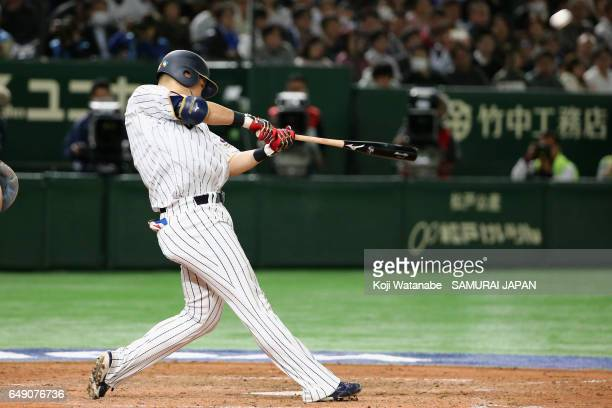 Outfielder Yoshitomo Tsutsugoh of Japan hits a tworun homer to make it 49 in the bottom of the seventh inning during the World Baseball Classic Pool...