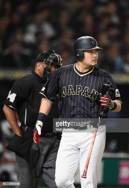 Outfielder Yoshitomo Tsutsugoh of Japan reacts after a strikeout in the top of the first inning during the World Baseball Classic Pool E Game Two...