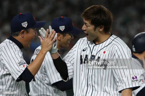 Outfielder Yuki Yanagita of Japan celebrates after hitting the gameending tworun home run in the bottom of 9th inning during the game one of the...