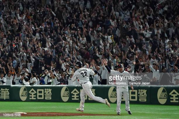 Outfielder Yuki Yanagita of Japan celebrates hitting the gameending tworun home run in the bottom of 9th inning during the game one of the Japan and...