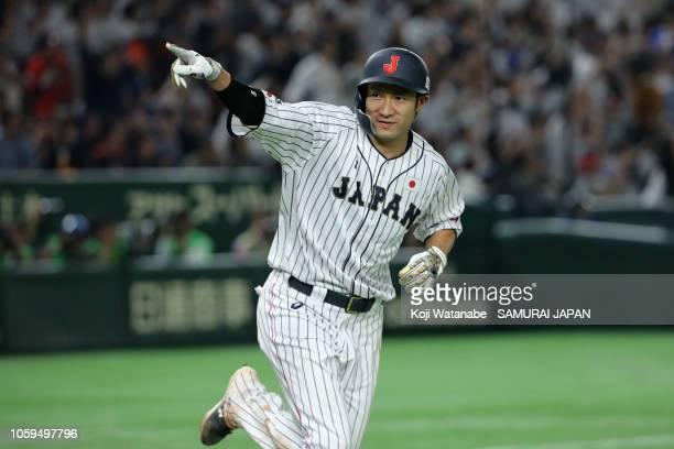 Outfielder Yuki Yanagita of Japan celebrates hitting the game-ending two-run home run in the bottom of 9th inning during the game one of the Japan...