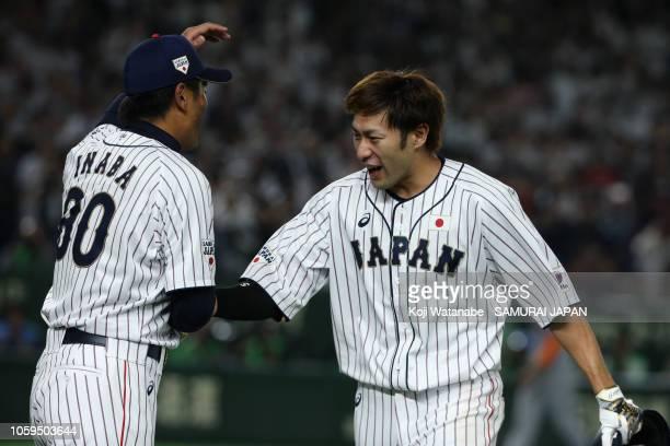 Outfielder Yuki Yanagita of Japan congratulated by Head coach Atsunori Inaba after hitting the game-ending two-run home run in the bottom of 9th...