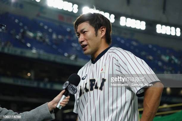 Outfielder Yuki Yanagita of Japan is interviewed by the Fox News prior to the game three of Japan and MLB All Stars at Tokyo Dome on November 11,...