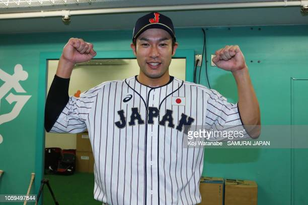 Outfielder Yuki Yanagita of Japan poses for photographs after hitting the game-ending two-run home run in the bottom of 9th inning during the game...