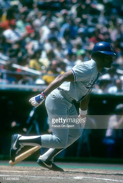 Outfielder/First Baseman Reggie Smith of the Los Angeles Dodgers puts the ball in play and heads towards first base during a Major League Baseball...