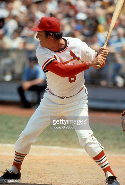 Outfielder/First Baseman Stan Musial of the St Louis Cardinals stands at the plate waiting on the pitch during a Major League Baseball game at Busch...