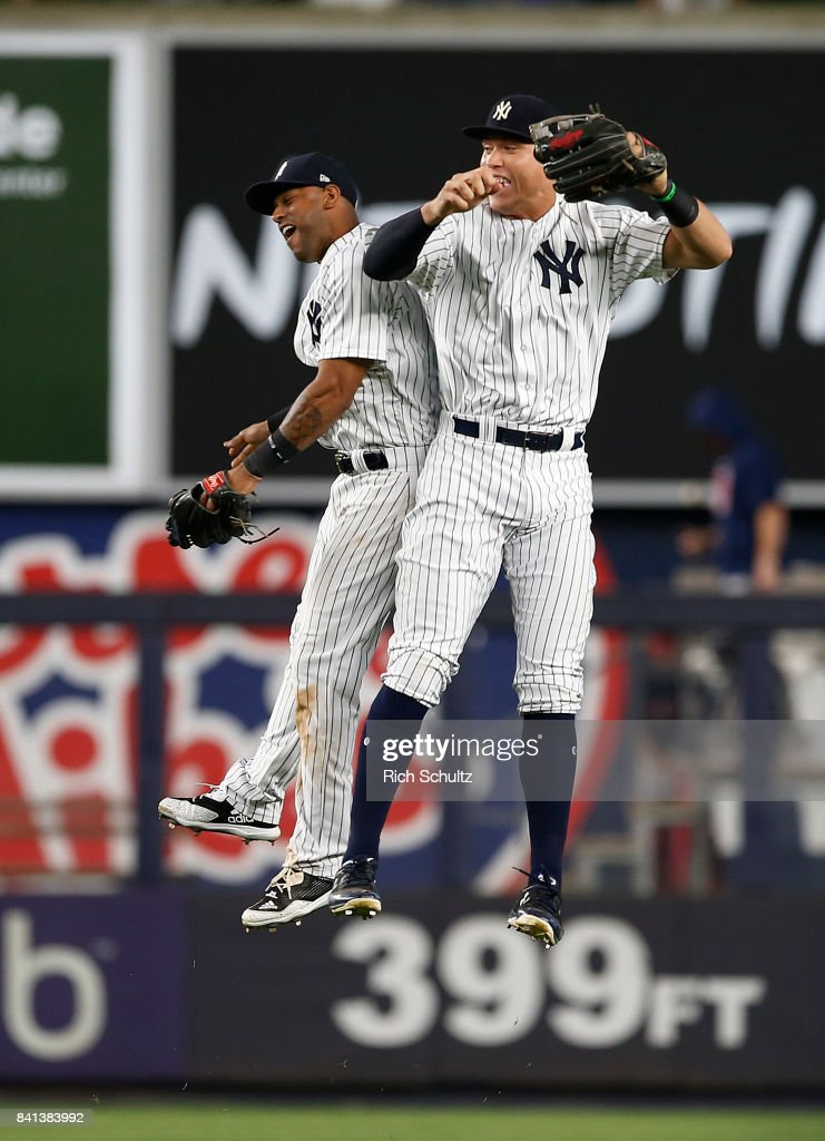 Outfielders Aaron Hicks #31 and Aaron Judge #99 of the New York Yankees celebrate their 6-2 win over the Boston Red Sox during a game at Yankee Stadium on August 31, 2017 in the Bronx borough of New York City.
