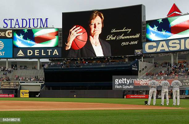 Outfielders Aaron Hicks Jacoby Ellsbury and Carlos Beltran of the New York Yankees stand for a moment of silence remembering Pat Summitt before the...