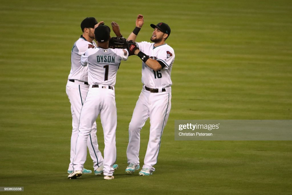 Outfielders A.J. Pollock #11, Jarrod Dyson #1 and Chris Owings #16 of the Arizona Diamondbacks celebrate after defeating the Los Angeles Dodgers 4-3 in the MLB game at Chase Field on May 1, 2018 in Phoenix, Arizona.