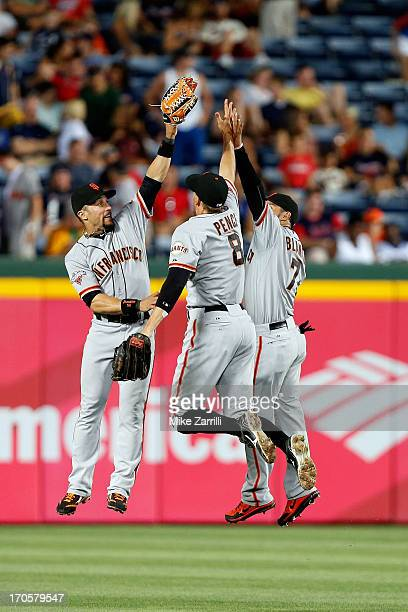 Outfielders Andres Torres Hunter Pence and Gregor Blanco of the San Francisco Giants celebrate after the game against the Atlanta Braves at Turner...