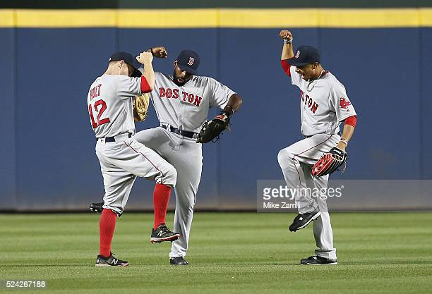 Outfielders Brock Holt Jackie Bradley Jr #25 and Mookie Betts of the Boston Red Sox celebrate after the last out in the ninth inning during the game...